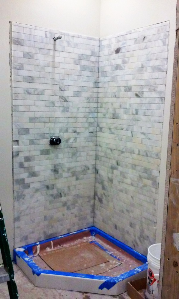 to install a shower tile