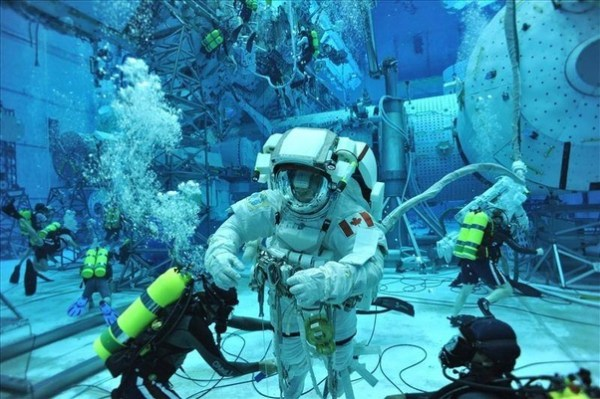 Could you go diving underwater with a spacesuit? - Quora