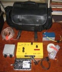 Paul Smith's (N0NBD) go bag includes a Hendricks PFR-3, BLT tuner, end-fed antenna wires, Norcal doublet, 1.2 AH SLA battery and a pad and pen. Click to enlarge.