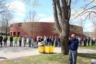 QU Athletic Director Jack McDonald takes pictures as line gets longer.