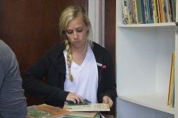 Kristyn cleaning books