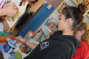 Adriana mixing paint