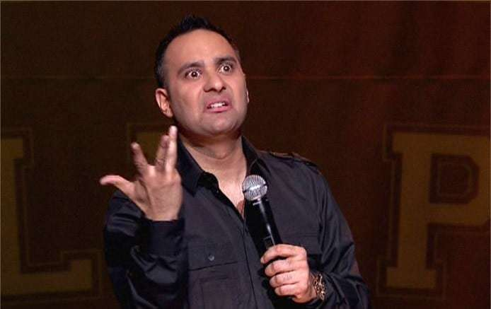 This is Russell Peters making the Indian nothing hand gesture. The face is pretty accurate too.