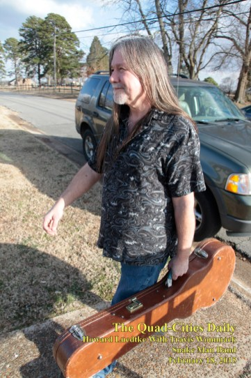 Howard Luedtke, guitar case in hand.