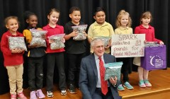 Mayor Marks with some of the first graders at Spark Academy who helped collect 39 pounds of cola tabs.