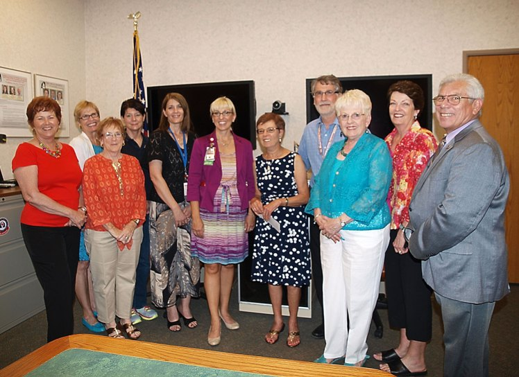 TWOQC Board members and VA staff are all smiles as Peggy McGee (in polka dot dress) presents a check for $10K to be used to purchase furniture for housing units for homeless veterans in the Tucson area.