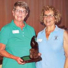 Gail Scheibner (left) with Mary Litfin, holding the Coveted Quail; photo by Sylvia Butler.