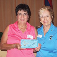 Left to right: Sally Geers was all smiles when she received the Quail Creek Star Putter brick for the lowest gross score from Lady Putters President Dee Waggoner; photo by Sylvia Butler.
