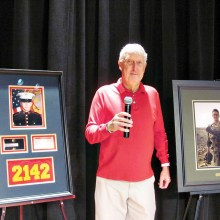 QC resident Jack Moberg shares the inspirational story of grandson, Matthew J. Determan, at the Veterans Day luncheon.