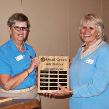 Putters President Cathy Thiele (left), presents the Lowest Average Net Score plaque to Neila Kozel who maintained an average of 34.4 for 2015; photo by Sylvia Butler.