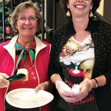 Laura Colbert and Christy Caldwell were among the volunteers at the HUD-VASH holiday celebration; photo by Peggy McGee.