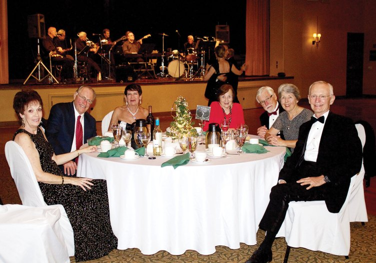 Enjoying the December dinner and dance are members Dodie Prescott, Len and Jana Eaton and Liz and Ken Eden with guests Claire and Orville Smith.