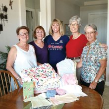 Presenting blankets and Comfort Hearts to Jeneane Catlin, RN are Sue Ann Obremski, Deb Migdalski, Susanne Fairman and Sherrie Morris.