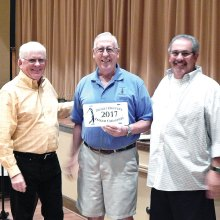 President Russ Sipe and Vice President Ed Pope present the 2017 Desert Duffer Golf Championship award to David Martinson.