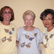 Left to right: Lee Schmidt, Kaye Siblik, and Yoshie Hennessy model the original putters' shirts (front and back); photo by Sylvia Butler.