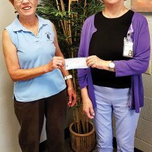 Left to right: Peggy McGee, on behalf of the Lady Putters, presented a check for $136 to Mary Jane Goodrick, Executive Director of Community Food Bank - Amado and Green Valley. This amount reflects the proceeds from the 50-50 raffle the Putters had in conjunction with its Moonlight Madness event. The raffle winner was Cathy Thiele, president of the Lady Putters; photo by Vicki Turner.