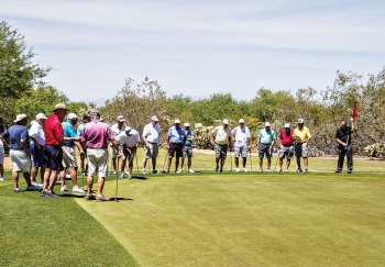 The playoff as the 12 teams approach the green on Coyote No. 1, the first elimination hole.