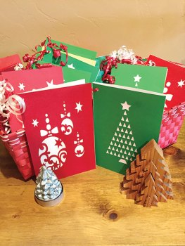 Members of TWOQC have created holiday cards which include a student name and information.