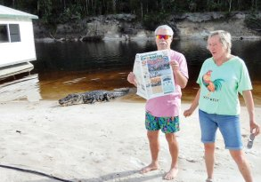 Alligator alert! Hugh and Ruth Spiegel just had to finish that last sentence in the Crossing while fishing in the Caymans.