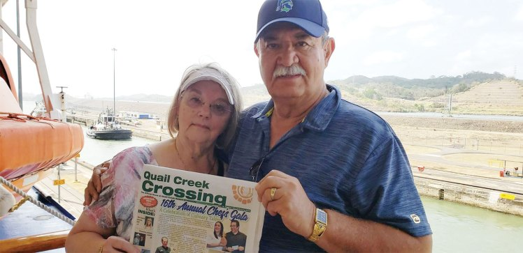 Tony and Bonnie Gourveia decided to read the Crossing while waiting to move through the Panama Canal locks on the Coral Princess.