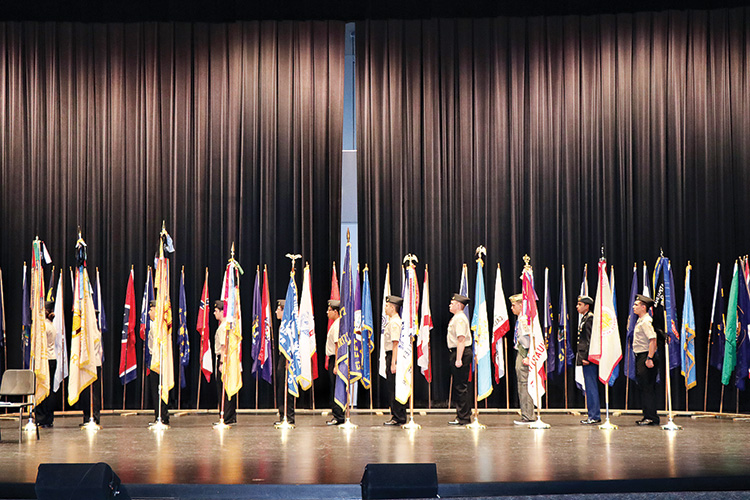 After posting the flags for all 50 states JROTC cadets from the local high schools placed the military service flags; photo by Peggy McGee.
