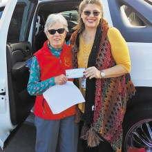 On behalf of the Lady Putters, Peggy McGee (left) presents a check for $200 to Karen Kuciver, founder of Women Warriors; Photo by Consuelo Williams.