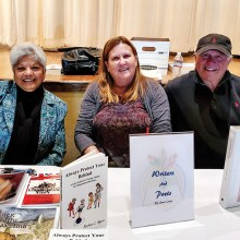 President Paul Riggins, with authors Barbara Ayers and Yasmin John-Thorpe.