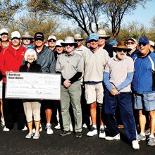 Several enthusiastic Quail Creek Desert Duffers were present to present Cheri Sipe, President of Quail Creek Nine Hole Ladies Golf Association, with a check for $500 from Duffers President Mike Senatra (blue sweater,) to help defray the cost of the Continental School District Junior Golf program sponsored by the Lady Niners.