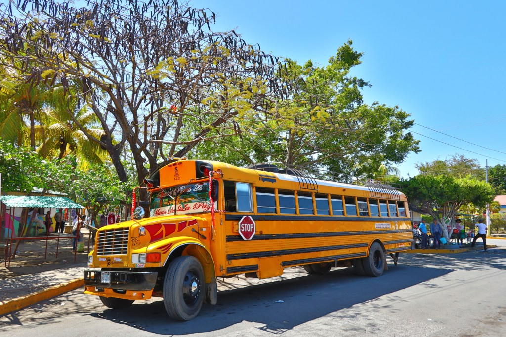 """<img src=""""chickenbus.jpg"""" alt=""""a picture of an old school bus AKA is it safe to travel in Latin America?"""">"""