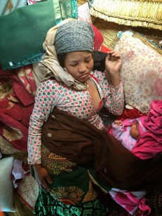 Uma Tamang gave birth to a baby boy five days after the quake, on May 1st. She sleeps in a makeshift shelter with her newborn.