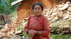 In Ward No 5. Kaili Tamang stands in front of her house. All the houses in the village were destroyed by the April 25 quake