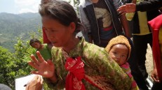 Rita Tamang, a mother of three, ran up the hill for fear she might miss the distribution like she did last time (her husband was lying drunk at home).