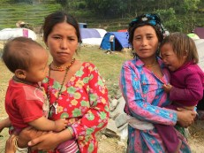 Maili Tamang and Thuli Tamang (sisters-in-law). The children in their arms (Thuli's nephew & niece) lost their mother in the quake. The family lost five members including Thuli's youngest sister and grandfather.