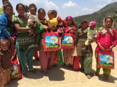 Ten mothers including several pregnant women received bags of new mother supplies