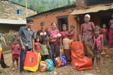 A Dalit family in Kafalsanghara village after they received the tents and new mother supplies.