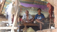 Nante Majhi (left). Having received 2 bundles of roofing sheets, he is relieved that he can now build a temporary shelter that can withstand the monsoon rain.