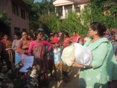 """Distributing packages separately prepared by our team and Nari Shakti cooperative"""""""