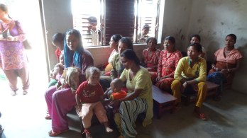 Pahari mothers wait to receive relief