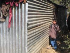 Raju Syngtan's family shed. Five members of the family live in this tin shed.