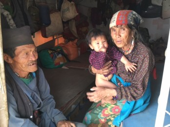 Little Dolma, born in the camp, with her grandparents