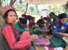 Women in Sankhule camp weave muda
