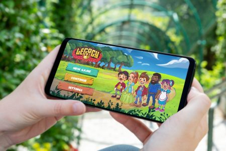 Person holding tablet with new game