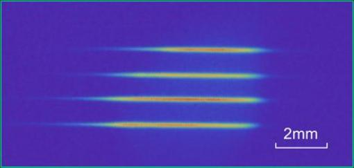 Fluorescence image of four laser-cooled atomic ensembles, each used as a quantum node in an entanglement distribution experiment by the Kimble group.