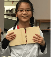 Young asian girl with board