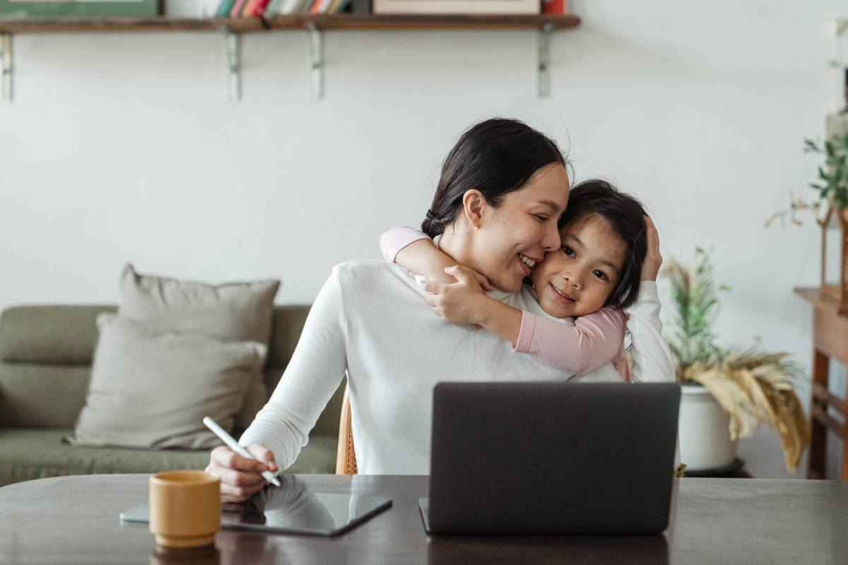 mother working at home with child