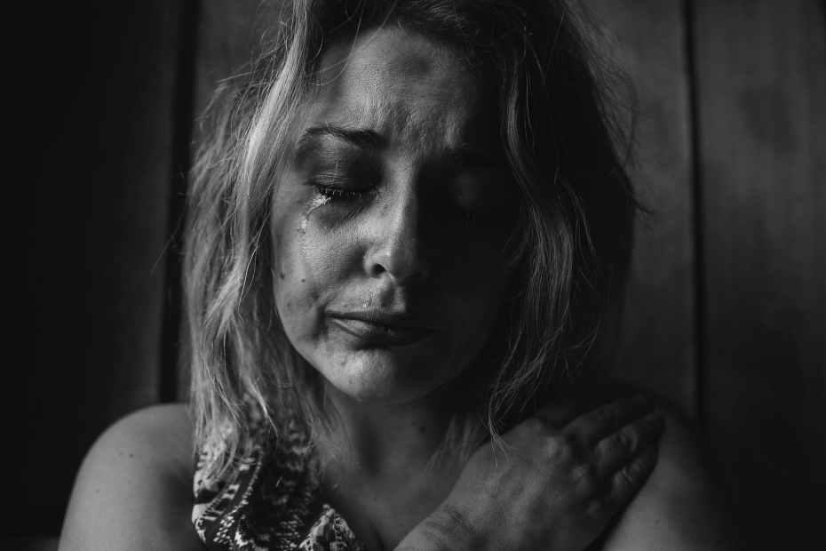 woman crying alone