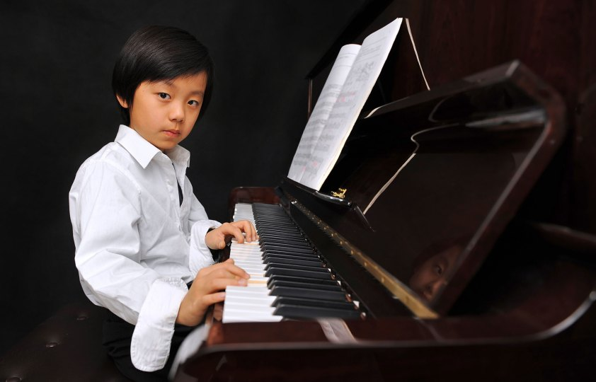 Boy sitting at the piano, Quassica Piano Lesson
