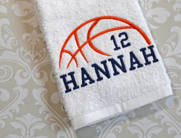 A personalized basketball gift that's a hand towel with the player's name and number