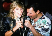 Freddie with Samantha Fox at the Queen party at Kensington Roof Gardens on 12th July 1986