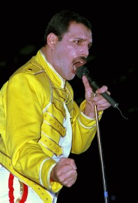 Freddie live on stage at Wembley Stadium in London in July 1986 as part of the European 'Magic Tour'. Photo by Phil Dent